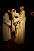 Receiving his stole from his uncle, Fr. John Reiker