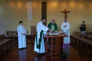 Assisting at Mass with his uncle, Fr. Bob Reiker