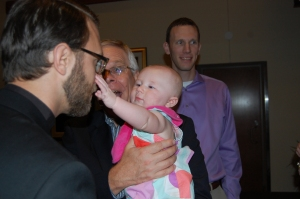 Niece Hannah gets to know her uncle Chris at the pre-ordination reception Friday evenings