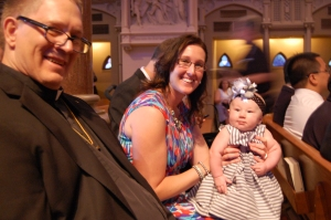 In church on Saturday, Uncle Gerard, Hannah and her mom Sarah awaiting the start of the big event.