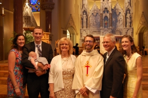 Immediate family gathers 'round the newly ordained Rev. Christopher J. Schroeder SJ.