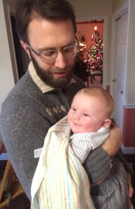 'No hard feelings'... Francis bonds with his uncle, Fr. Chris, after the sacramental dousing